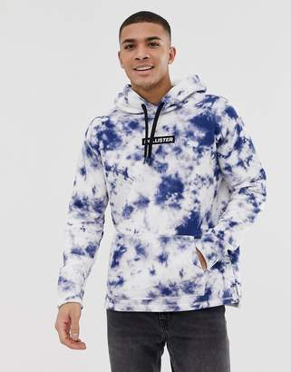 Hollister small chest logo acid wash overhead hoodie in blue exclusive at asos