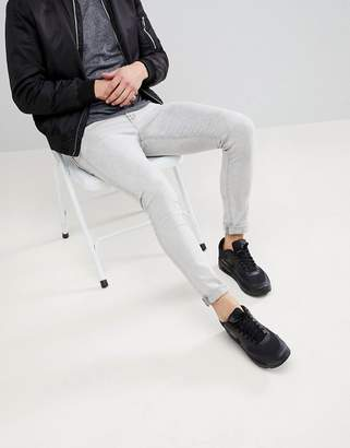 Asos DESIGN Super Skinny Jeans In Light Gray With Abrasions