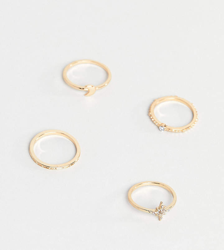 ASOS Curve ASOS DESIGN Curve pack of 4 rings with star and moon design in gold