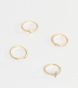 Asos DESIGN Curve pack of 4 rings with star and moon design in gold