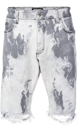 Represent distressed tie-dye shorts