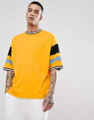 Asos DESIGN oversized t-shirt with color blocking in yellow