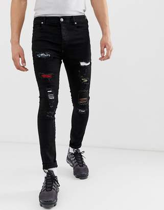 Sixth June super skinny jeans in black with multi print distressing