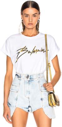 Balmain Logo Crew Neck T Shirt in White & Gold | FWRD