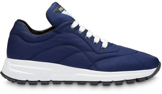 Prada stitched panels low top sneakers