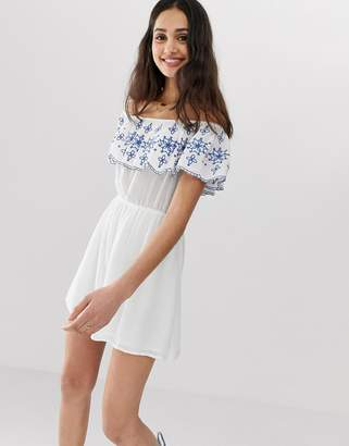 En Creme bardot mini dress with embroidered frill detail