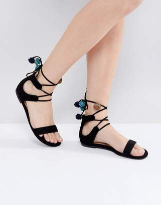 Call it SPRING Mckeague Lace Up Pom Pom Sandals