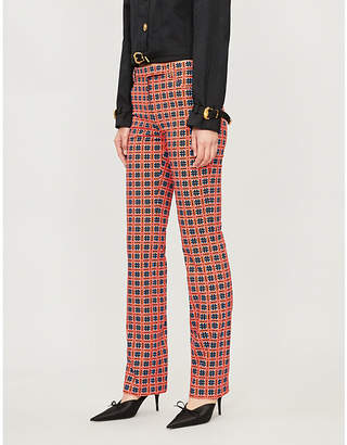Versace Geometric-patterned slim-fit stretch-cotton trousers
