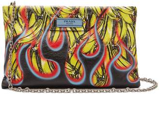 Prada Banana and flames-print leather clutch