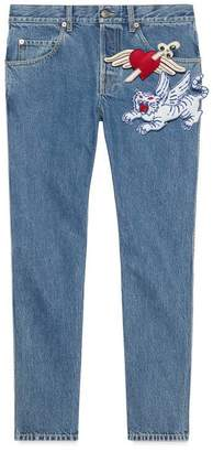 Gucci Tapered denim trousers with brooches