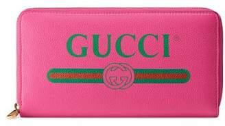 Gucci (グッチ) - 〔グッチ プリント〕 レザー ジップアラウンドウォレット