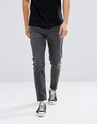 Asos DESIGN tapered jeans in washed black