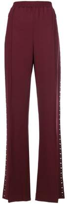 Area pleated studded trousers