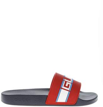 Gucci Red Rubber Slide Sandals With Embossed Logo