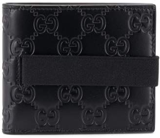 Gucci embossed GG wallet