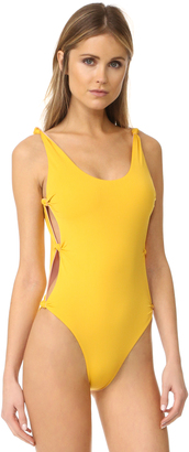 Red Carter Reversible Knot Side Swimsuit $160 thestylecure.com