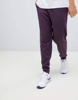 Asos DESIGN slim joggers in dark purple