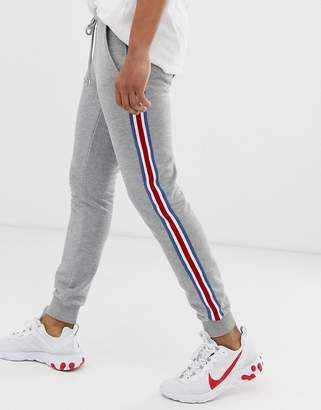87b78743 Asos Design DESIGN skinny joggers with side stripe taping in grey marl