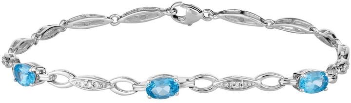 10k White Gold Swiss Blue Topaz & 1/10 Carat T.W. Diamond Bracelet