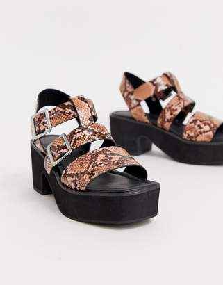 Asos Design DESIGN Helper chunky mid-heeled sandals in pink snake