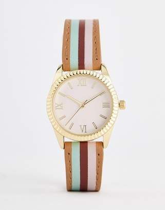 Asos DESIGN watch with color block stripe strap and pink face in gold