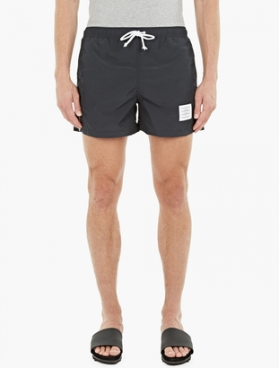 Thom Browne Navy Nylon Swimshorts $182 thestylecure.com