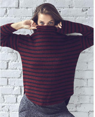 Express striped mock neck shirttail hem sweater $59.90 thestylecure.com