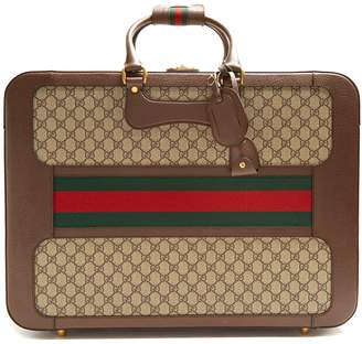 Gucci GG Supreme canvas and leather suitcase