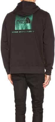 The North Face Red Box Pullover Hoodie in TNF Black & Iridescent Multi | FWRD