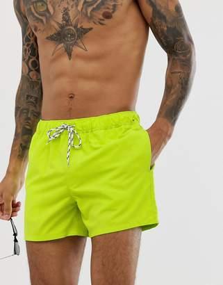 82c51d5be43f0 Asos Design DESIGN swim shorts in neon green short length with black &  white drawcord