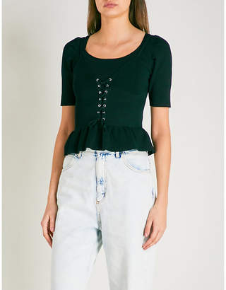 Sandro Lace-up detail knitted peplum top