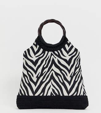 Accessorize zebra print straw bag with interest handle