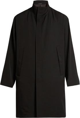 YOHJI YAMAMOTO Funnel-neck wool-gabardine coat $1,877 thestylecure.com