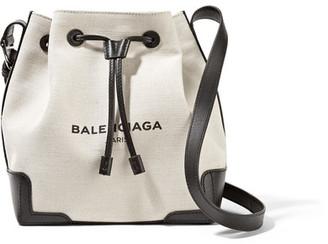 Balenciaga - Bucket Leather-trimmed Canvas Shoulder Bag - Ecru $1,055 thestylecure.com