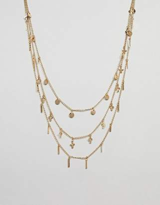 Asos DESIGN multirow necklace with mixed charms in gold
