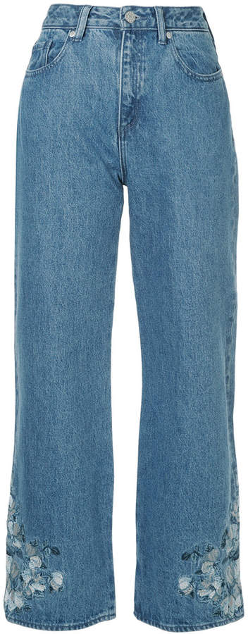 CLANE embroidered flared jeans