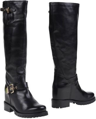 LUCIANO PADOVAN Boots $504 thestylecure.com