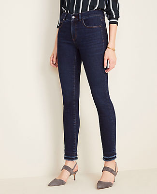 Ann Taylor Petite Curvy Sculpted Pockets Frayed Skinny Jeans in Classic Mid Wash