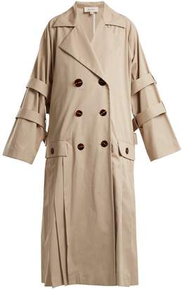 Oversized pleated trench coat