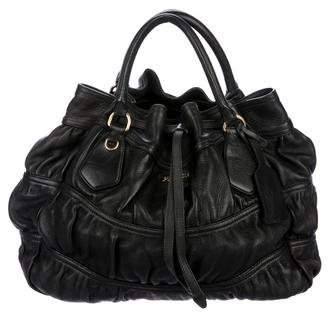 fc9d88a3eb17 ... greece pre owned at therealreal prada cervo gaufre drawstring tote  22667 98ee7