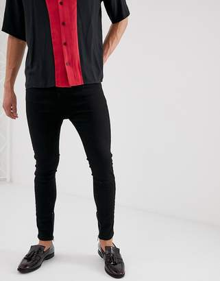 Religion drop crotch skinny jean with ripped back in black