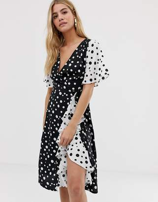 Influence frill skirt detail midi dress with wrap front in mix and match polka dot print