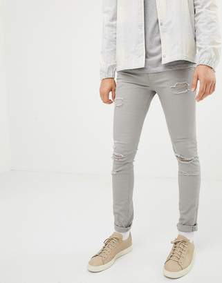 Jack and Jones skinny jeans in destroyed gray denim