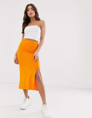 Asos Design DESIGN bias cut jersey midi slip skirt with split