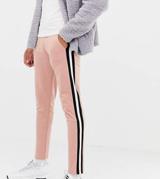 Asos Design DESIGN tall skinny joggers in poly tricot with side stripe in pink