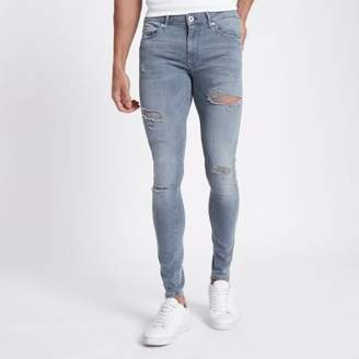 River Island Blue ripped Ollie super skinny spray on jeans