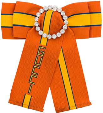 Gucci bow slogan brooch