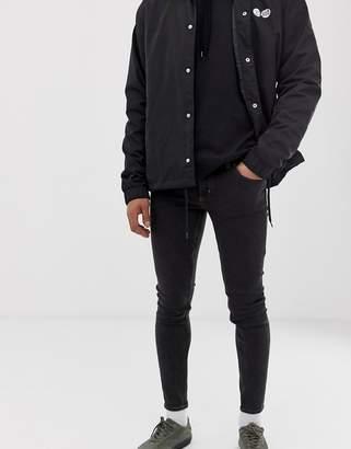 Cheap Monday him spray super skinny jeans in black terra