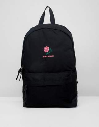 Asos Design Backpack In Black With Don't Bother Rose Embroidery