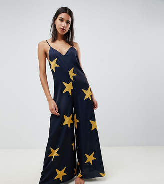 Asos DESIGN star print satin plunge jumpsuit